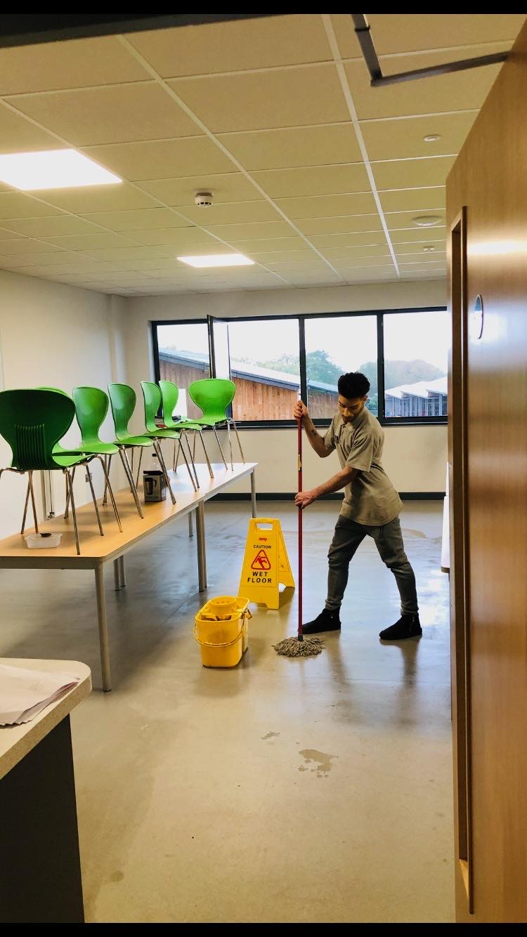 Staff mopping and cleaning commercial offices
